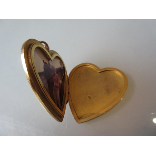 924 - Large 15ct gold heart shaped locket set with a single sapphire...