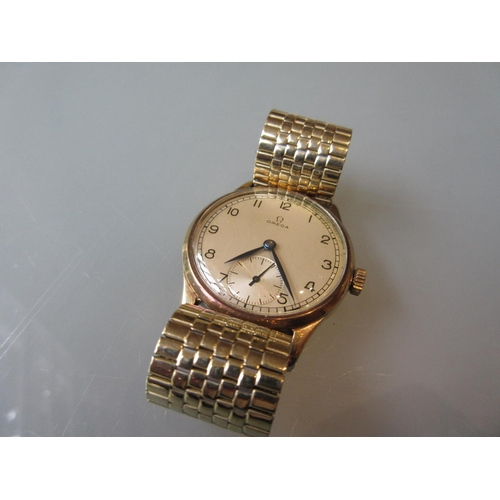 932 - Gentlemans 1940's Omega 9ct gold cased wristwatch, the silvered dial with Arabic numerals and subsid...