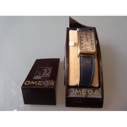 933 - Gentleman's 1930's Omega rectangular 9ct gold cased wristwatch, the silvered dial with Arabic numera...