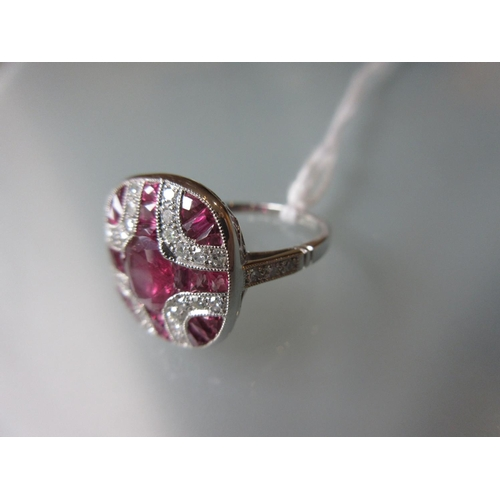 934 - Art Deco style platinum panel ring set rubies and diamonds...