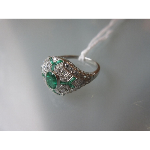935 - Victorian style platinum ring set emeralds and diamonds in a filigree style mount...