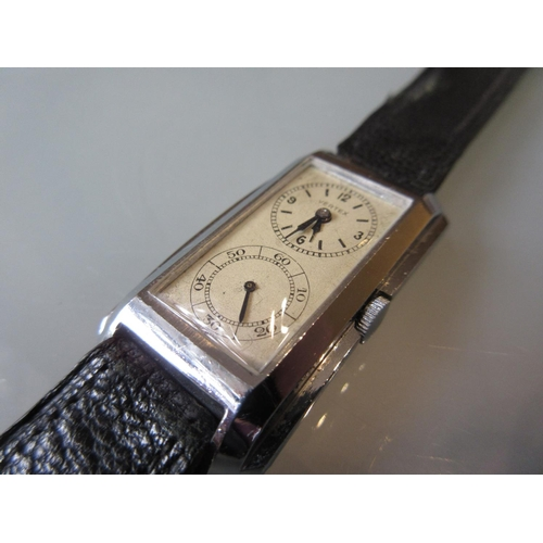 938 - Gentleman's Vertex 1940's rectangular dual dial wristwatch, the dial with Arabic numerals on a black...
