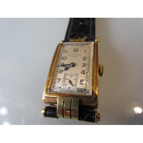 939 - Gentleman's West End Watch Co., Bombay / Calcutta, 18ct gold cased wristwatch, the silvered dial wit...