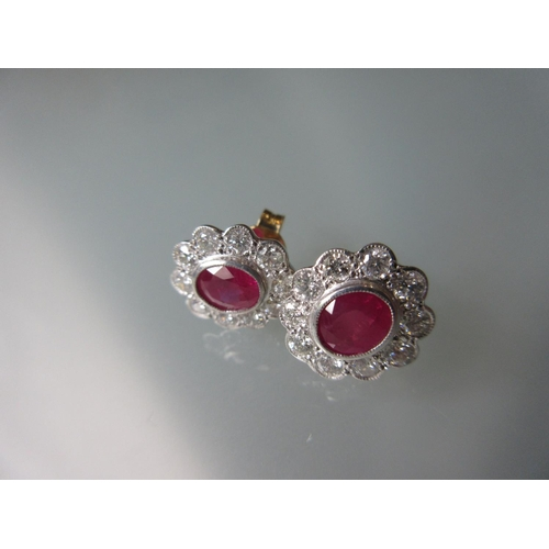 940 - Pair of 18ct yellow gold oval ruby and diamond stud earrings...