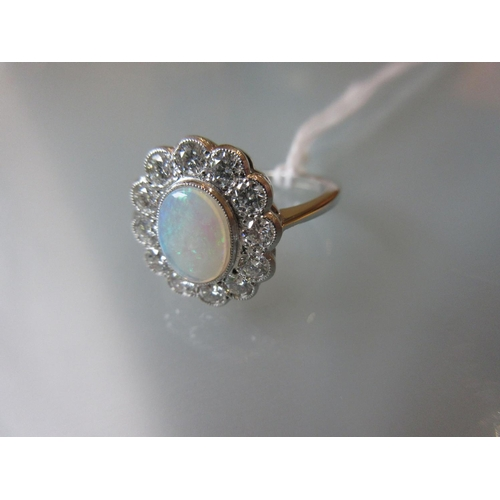 941 - Platinum oval opal and diamond cluster ring...