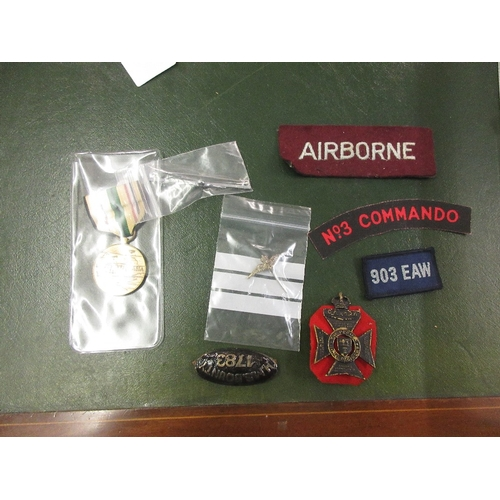 131 - Collection of mixed military cap badges and related items...