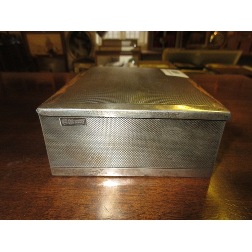 698 - Sterling silver box with engine turned decoration and cedar lined interior, bearing an Omega motif, ...