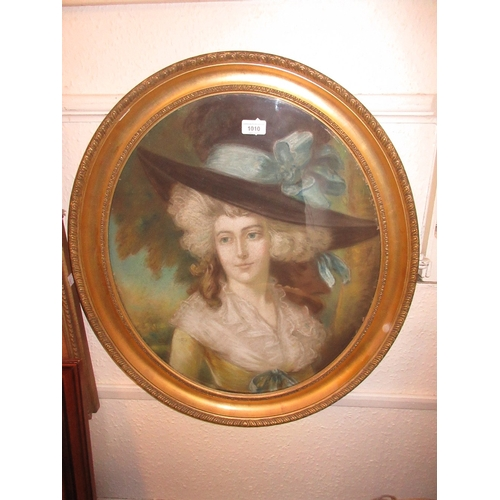 1010 - Pastel portrait of a lady wearing a wide brimmed hat, oval gilt framed together with a similar colou...