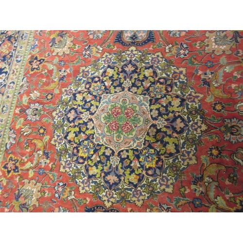 12 - Pair of Tabriz rugs having central medallion with all-over floral design and multiple borders on a w...