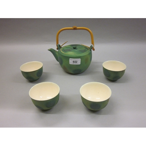 642 - Japanese sake / teapot and four cups decorated in a mottled green matt glaze...