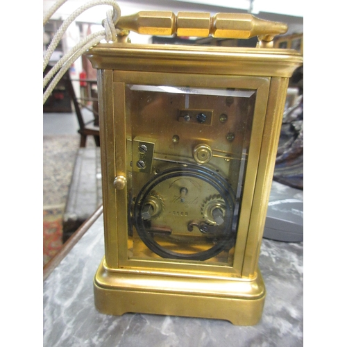 1400 - 20th Century gilt brass cased carriage clock having repeat function and enamel dial with Roman numer...