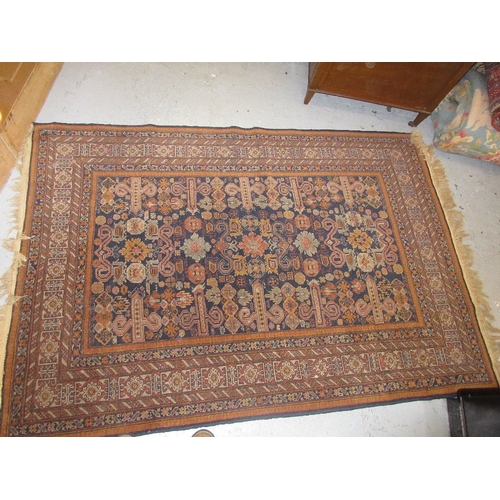 18 - Turkish rug of Caucasian design with an all-over stylised floral and rams head design on a midnight ...