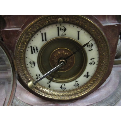 1352 - Unusual 19th Century French rouge marble and gilt metal mounted mantel clock, the enamel and brass d...