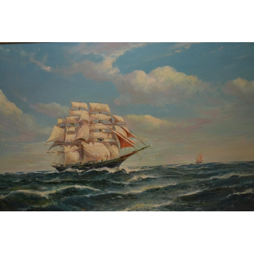 1008 - Early 20th Century oil on canvas, three masted sailing ship in heavy seas, signed indistinctly, 29in...