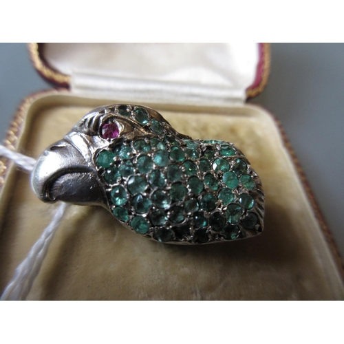 788 - White metal brooch in the form of a parrot's head having ruby set eye and set emeralds (enamel worn)...