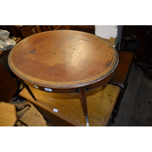 2024 - Edwardian mahogany and line inlaid oval occasional table with leather inset top, 28.75ins wide...