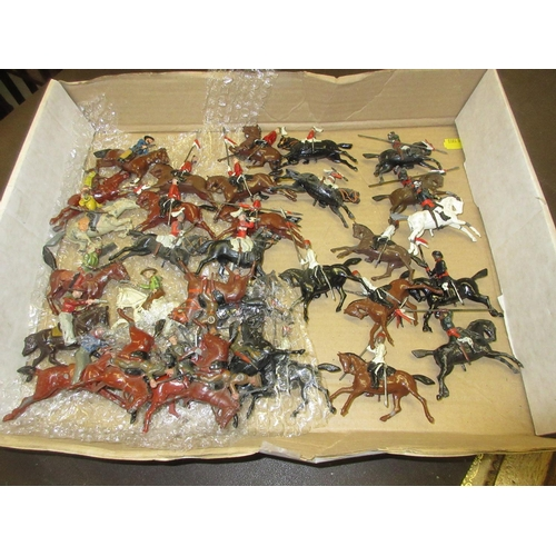 76 - Five sets of five Britain's diecast metal mounted military figures, together with a set of eight mou...