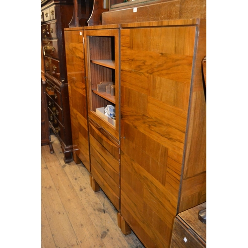 1554 - Mid 20th Century Continental figured walnut three section side cabinet, the centre with a door above...