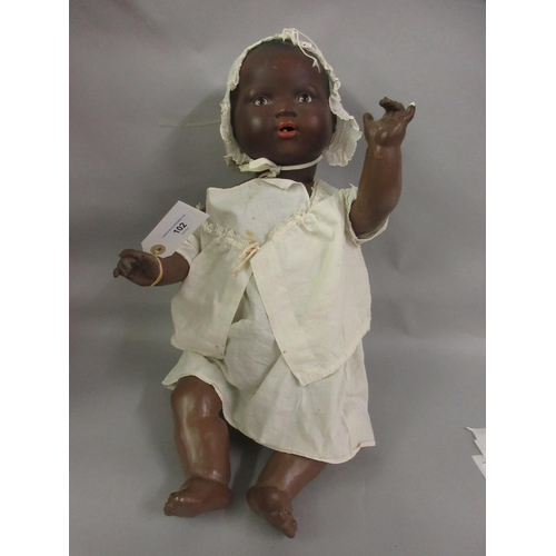 102 - Armand Marseille Germany 351 / 8K bisque headed doll with a jointed composition body, wearing a whit...