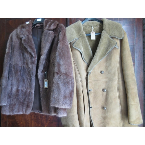 11 - Ladies mid brown fur jacket, together with a sheepskin coat...