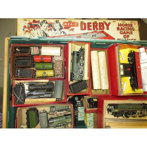 124 - Quantity of Trix Twin model railway, a Merritt Derby horse racing game and a table croquet set...