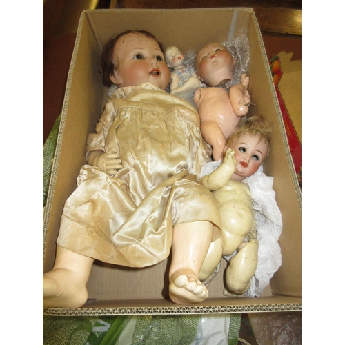 130 - Small Armand Marseille bisque headed baby doll (at fault), another similar bisque headed doll (crack...