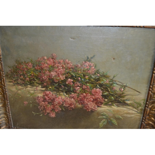 1353 - Late 19th/early 20th Century oil on canvas, still life study of cut flowers on a table, signed indis...