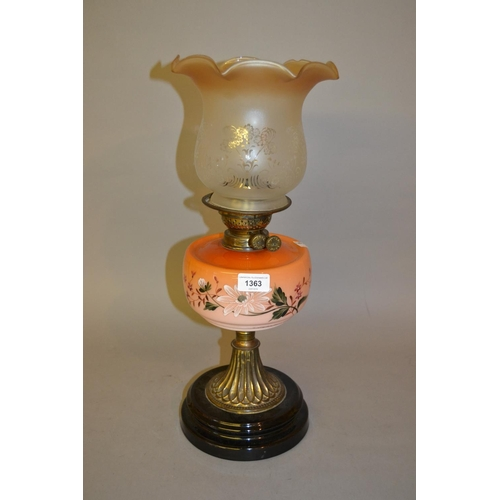 1363 - Brass oil lamp with a painted glass well and an etched glass shade...