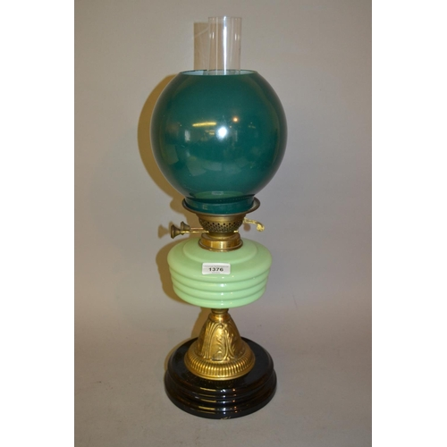 1376 - Victorian green opaque glass and brass oil lamp...