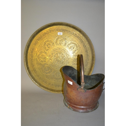 1403 - Circular Benares type brass tray with engraved decoration and a copper helmet shaped coal scuttle...