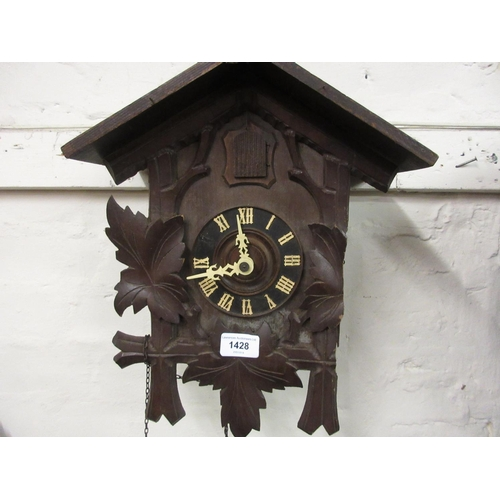 1428 - Swiss carved wooden two train weight driven cuckoo clock...