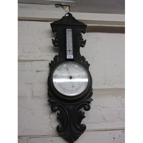 1429 - Victorian carved oak aneroid barometer / thermometer...