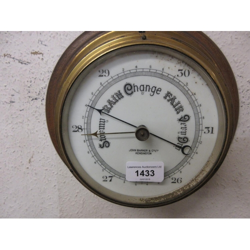 1433 - John Barker and Co., Kensington, circular gilt brass ship's bulkhead barometer...
