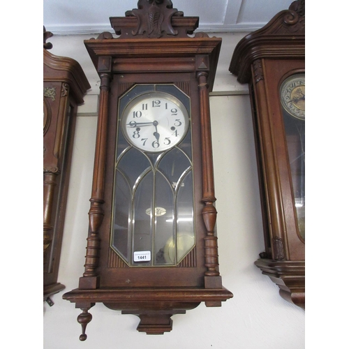 1441 - Early 20th Century Continental beechwood Vienna style wall clock with a carved surmount decorated wi...