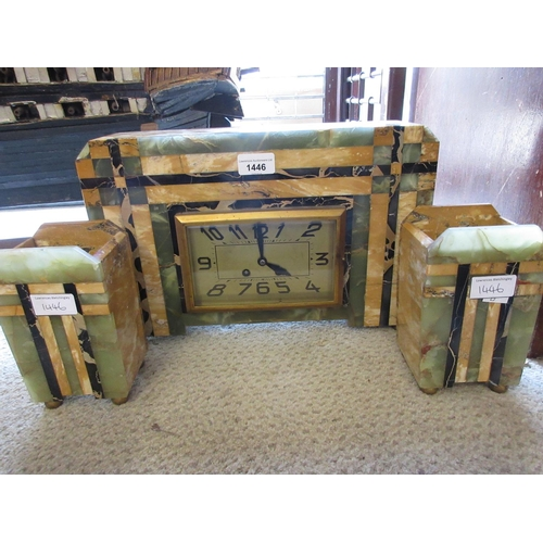 1446 - Art Deco green and yellow onyx cased mantle clock of rectangular form, the gilt dial with Arabic num...