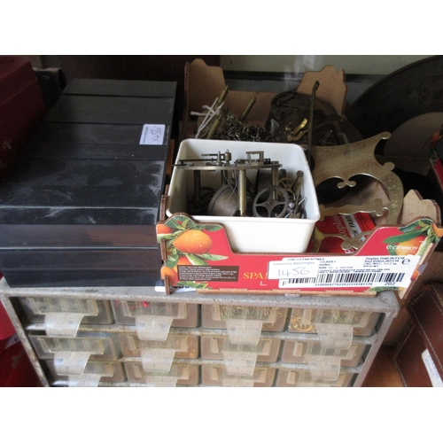1456 - Two multi drawer table cabinets containing a quantity of clock related spares, parts, hinges, bolts,...