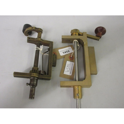 1459 - 19th Century brass spring winder together with a similar 20th Century tool...