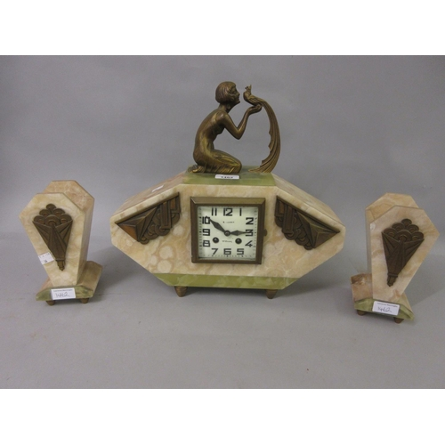 1462 - Art Deco beige and green onyx mantel clock with gilt metal mounts, surmounted by a kneeling figure o...