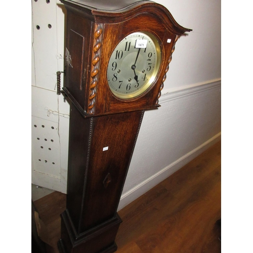 1471 - 1930's Oak grandmother clock, the silvered dial with Arabic numerals and three train movement...