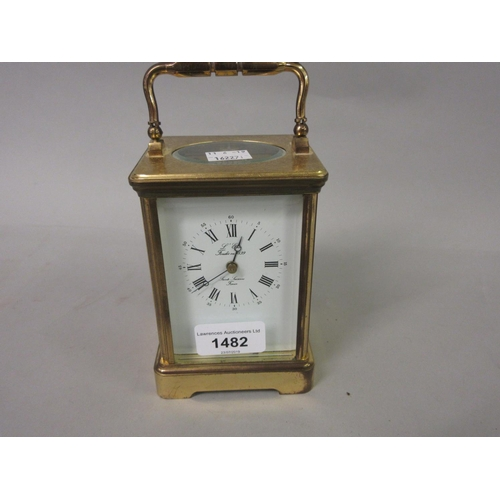 1482 - 20th Century brass cased two train carriage clock, having enamel dial with Roman numerals, inscribed...