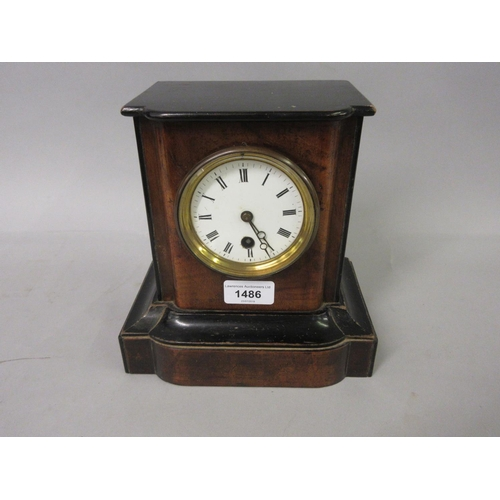 1486 - Small walnut and ebonised mantel clock with enamel dial, Roman numerals and single train movement...