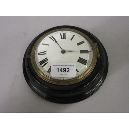 1492 - George III circular ebonised Sedan clock, the enamel dial with Roman numerals, the single train fuse...