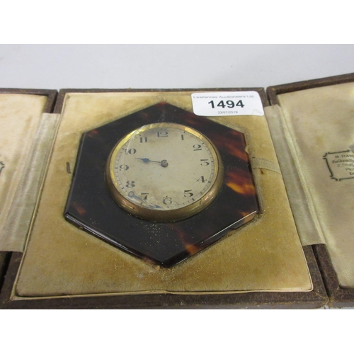 1494 - Cased tortoiseshell travel clock (at fault), together with a circular aneroid barometer...