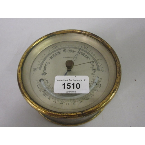 1510 - Early 20th Century circular brass cased thermometer/barometer with silvered dial, 4.75ins diameter...