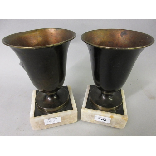 1514 - Pair of Art Deco patinated metal side urns on marble plinth bases...