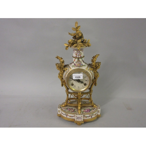 1529 - Reproduction French style porcelain and gilt metal two train mantel clock...