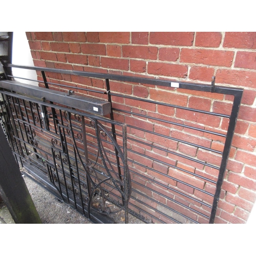1533 - Modern black painted iron garden panel with scroll work decoration fitted on iron posts, together wi...