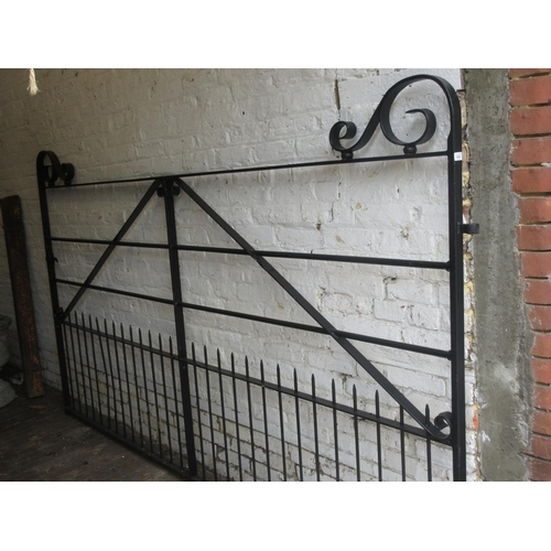 1536 - Modern good quality black painted wrought iron double gate having scroll work detailing and integral...