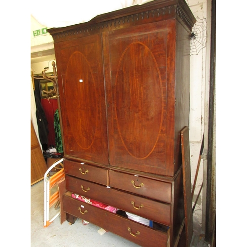 1537 - 19th Century mahogany linen press having a moulded cornice above two flush panelled oval crossbanded...