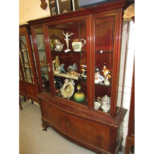 1538 - Mid 20th Century Continental stained wood and burr walnut display cabinet, the central bevelled glas...